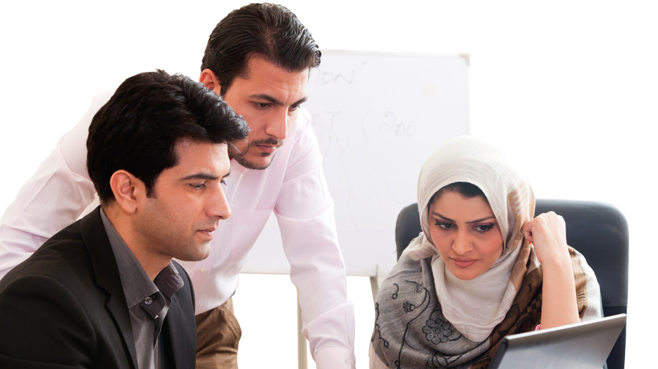 Arab business woman in a meeting with colleagues